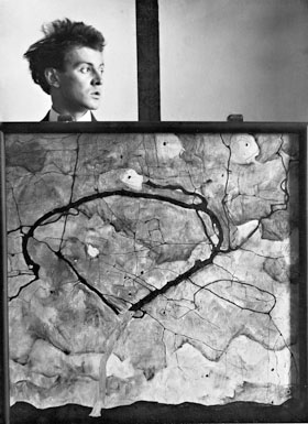 "Egon Schiele behind the painting ""Autumn Tree in Stirred Air (Winter Tree)"", 1912"
